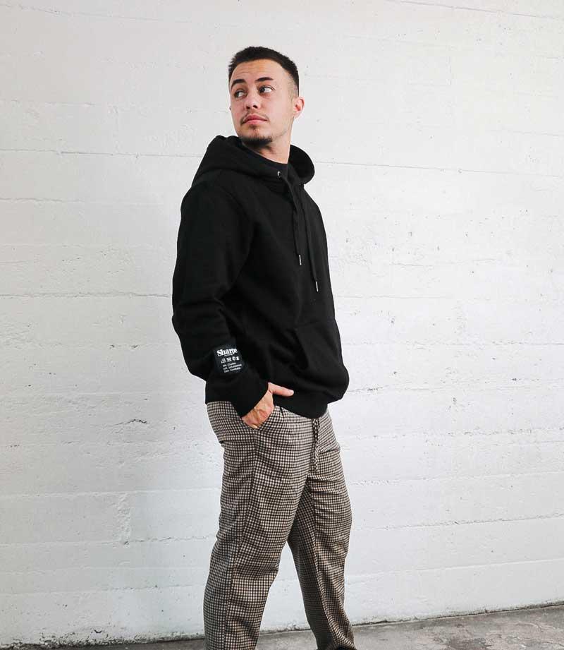 Black Vintage Label hoodie on Sharpe model